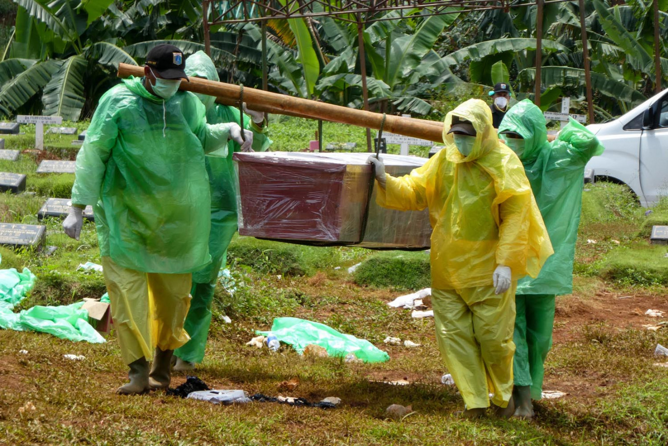 Authorities assure safety as locals protest burial of people with coronavirus