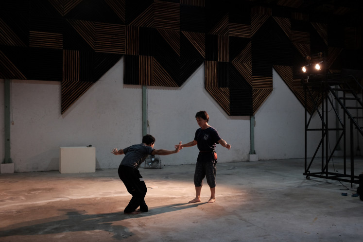 Live rehearsal: Japanese mime artist Naoki Nagai (right) works with Kudus-born Asita Kaladewa during a rehearsal for 'Nafas Nafsu', to which he contributed dramaturgy and music.