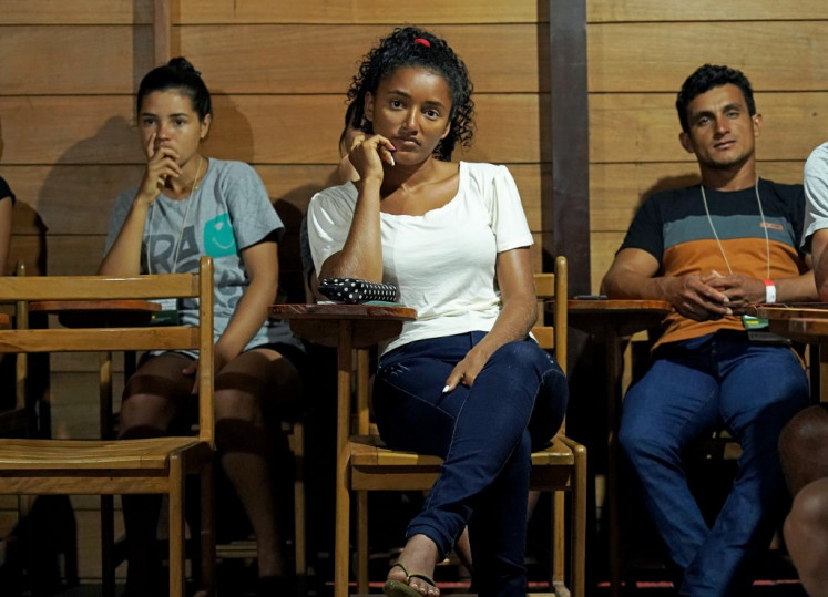 Twenty-two-year-old Kelita do Carmo (C) sits in class in the small faculty built by the Sustainable Amazon Foundation in the municipality of Carauari, in the heart of the Brazilian Amazon Forest, on March 15, 2020.
