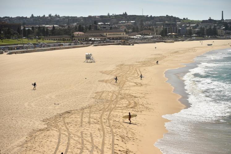 Bondi Beach to reopen for surfing as Australia virus cases slow