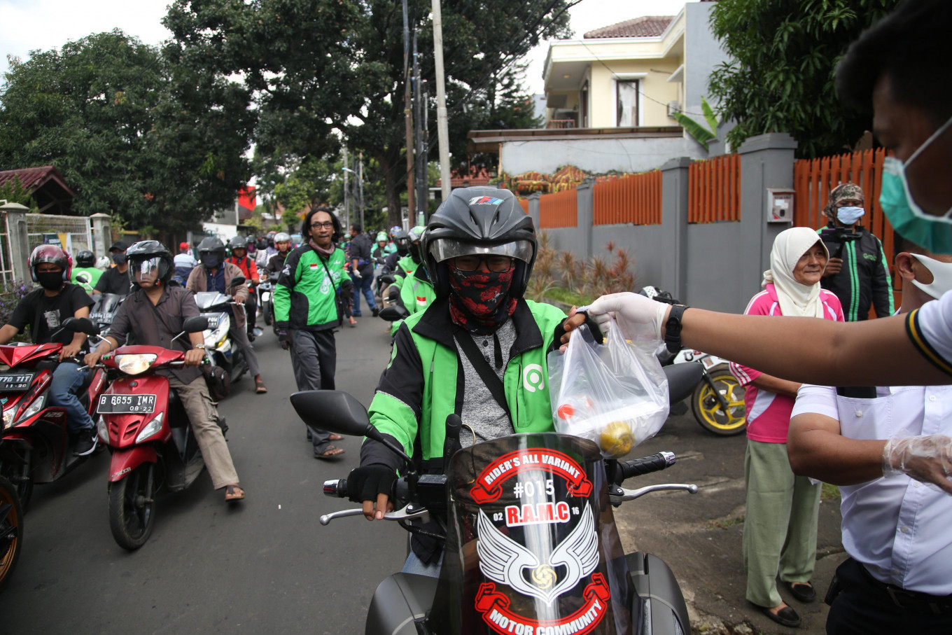 App-based 'ojek' drivers demand compensation as new social restrictions bar them from taking passengers