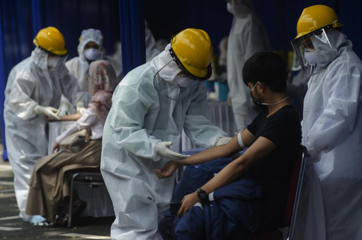 Cases surge by record 2,657 after West Java military academy outbreak