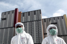 Indonesian Red Cross staff prepare to sterilize Wisma Atlet Kemayoran in Jakarta on March 21. 2020 prior to the opening of the COVID-19 hospital there. JP/Seto Wardhana