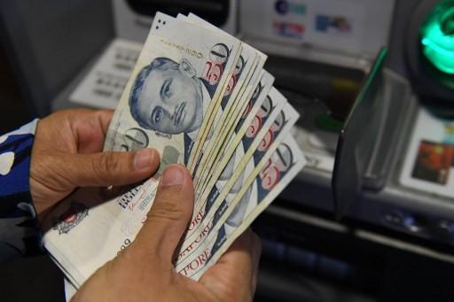 Singapore adds S$5.1 billion to stimulus, boosts handouts