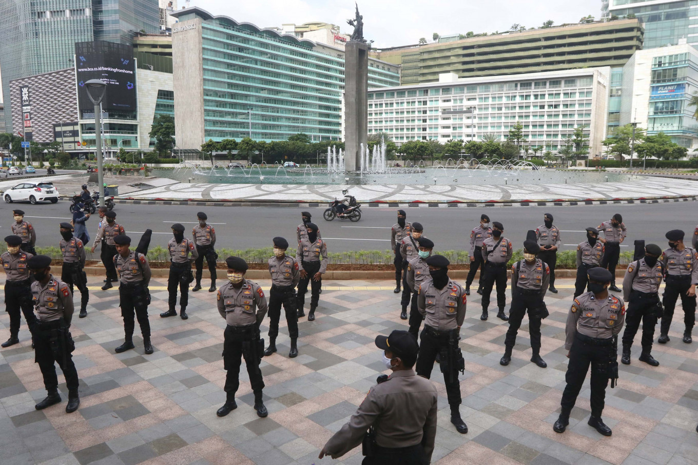 COVID-19: Nearly 78,000 police to guard transition to Indonesia's 'new normal'