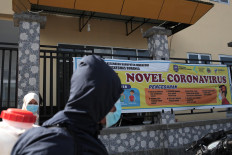 A community health center (Puskesmas) in Buranga subdistrict in Kaledupa Island installs a banner showing measures to curb the coronavirus spread. JP/ Edy Susanto