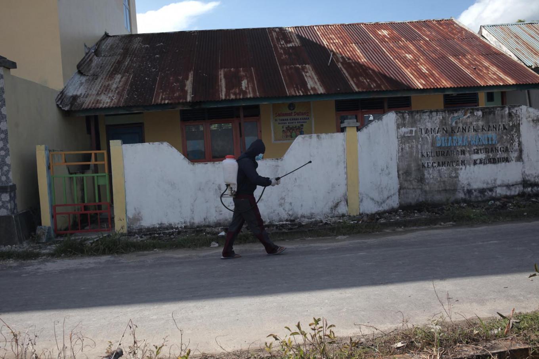 A disinfectant worker checks his sprayer. JP/ Edy Susanto