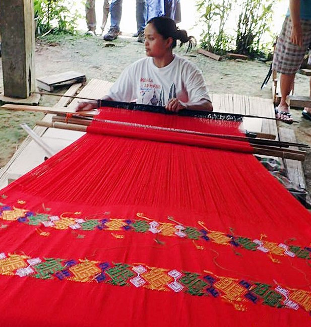 Art of weaving: A weaver makes a traditional textile on a backstrap loom in Toraja, South Sulawesi. Toraja Melo started working with weavers in the area in 2008.