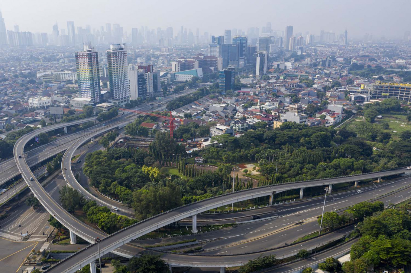 Uneasy calm descends on empty Jakarta as capital makes it through first day of social restrictions