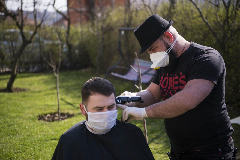 Kosovo's traveling barber keeps hair trimmed in virus lockdown