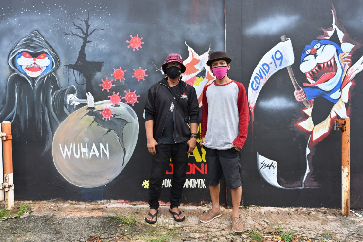 Scythes and monsters: Indonesian artists teach coronavirus care