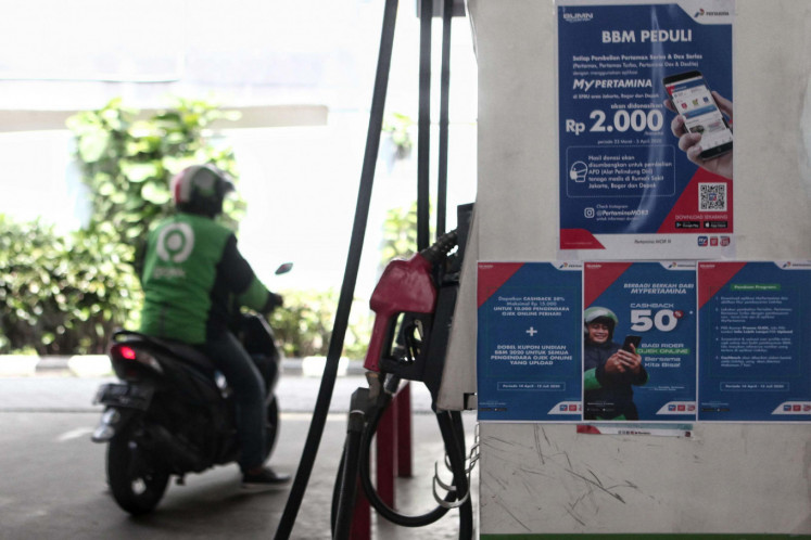 A sign of MyPertamina apps service are seen at Cikini gas station, Jakarta, Tuesday, April 14, 2020.