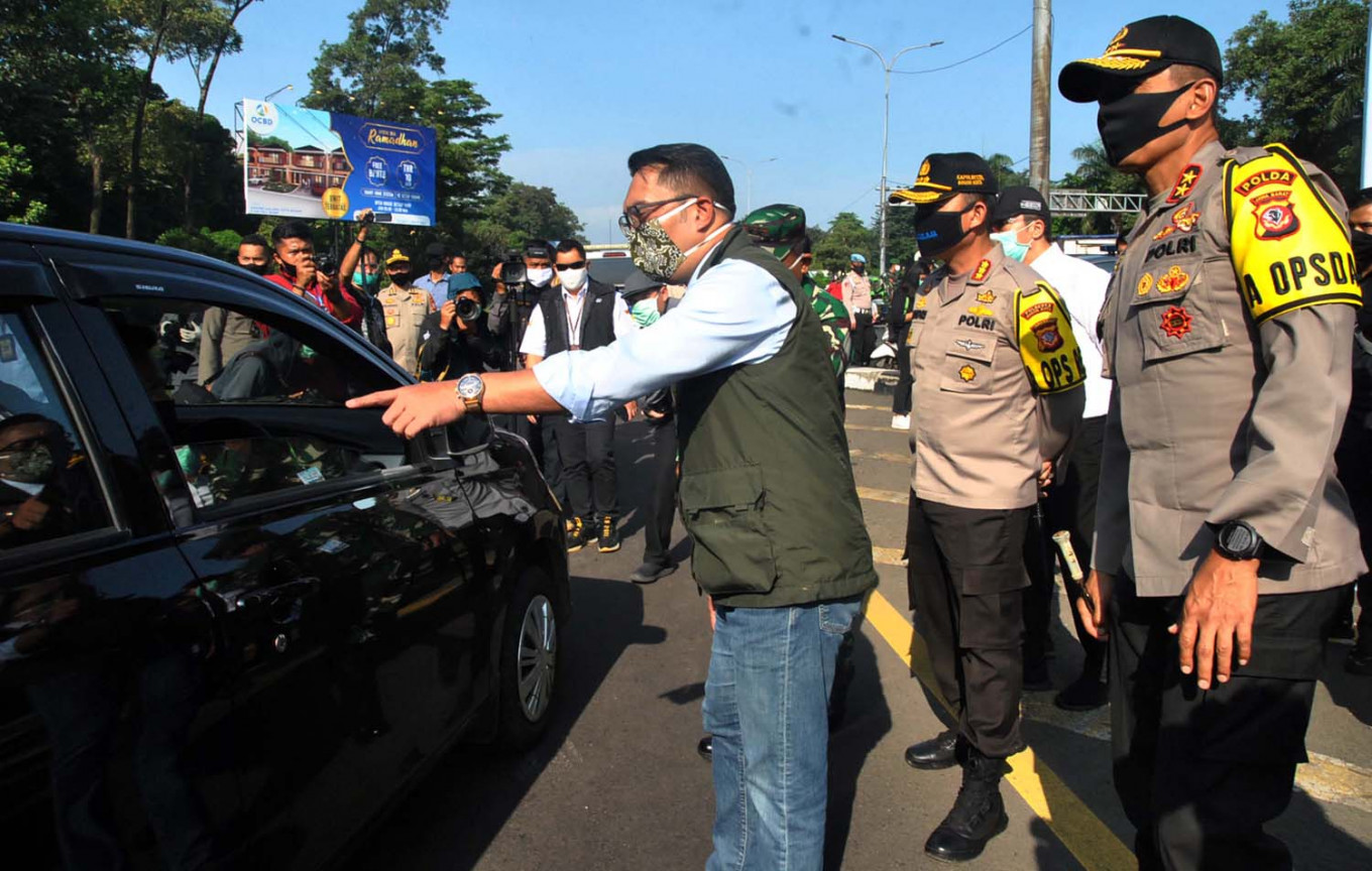 COVID-19: West Java to enforce fines, community service for violators of face mask rule