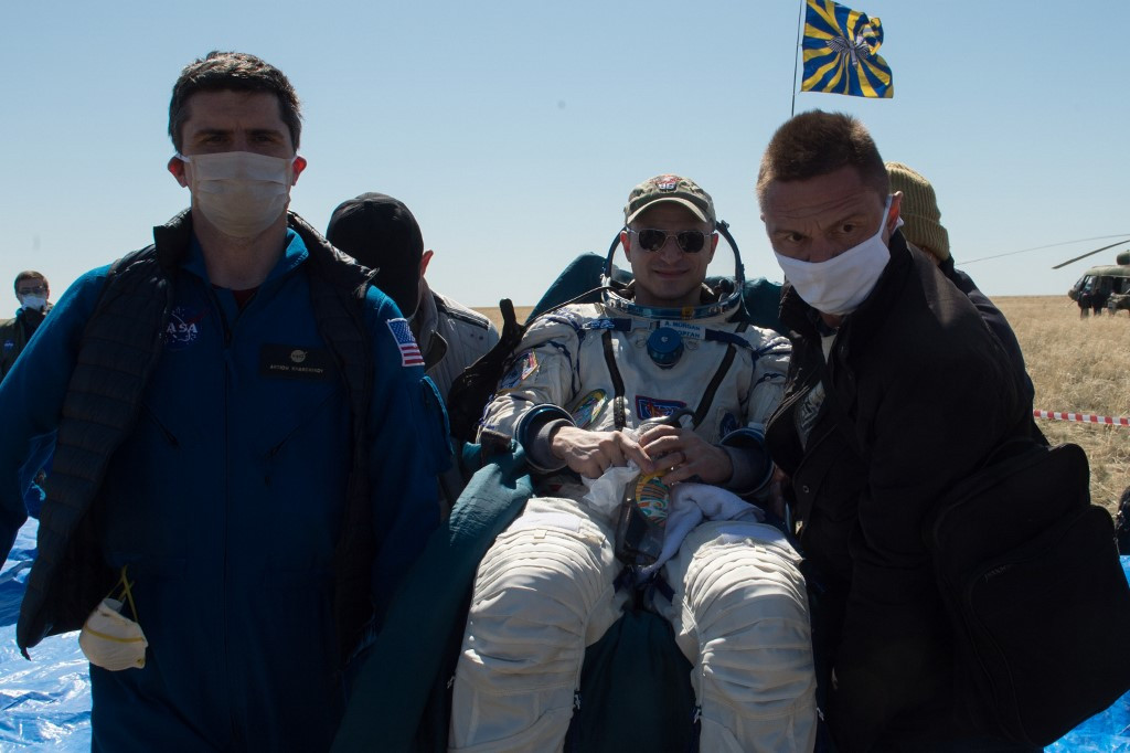 Astronauts land back on Earth transformed by pandemic