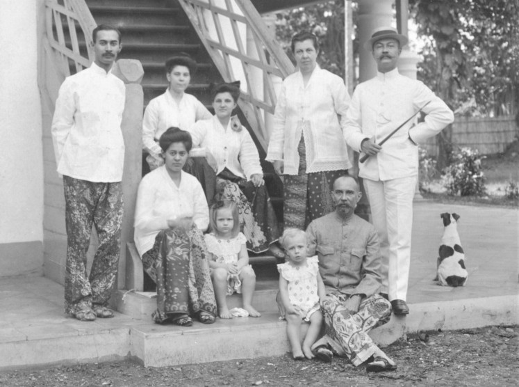 Generations: A photograph of the author's grandmother and great-great-grandparents in front of the Tanah Abang Bukit house in 1908.