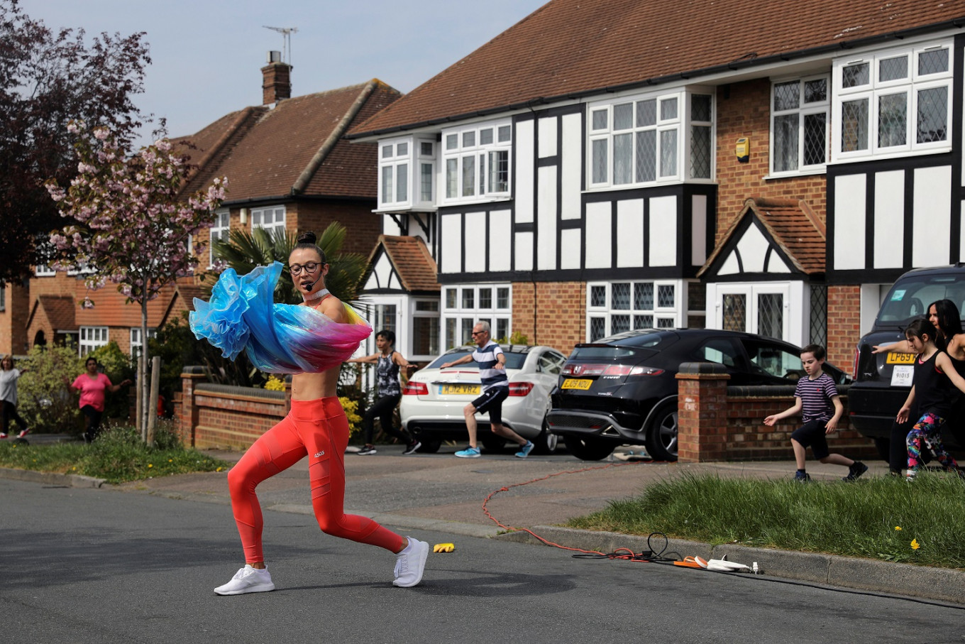 In lockdown Britain, 'Mancunian Motivator' brings fun and fitness to neighbors