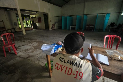 Indonesia locks virus violators in 'haunted house'