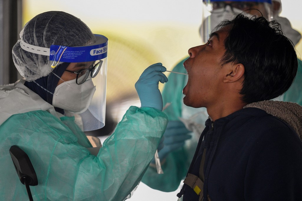 Nearly 100 Malaysians who recently returned from Indonesia test positive for COVID-19