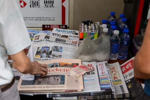 South China Morning Post cuts management pay, puts staff on unpaid leave