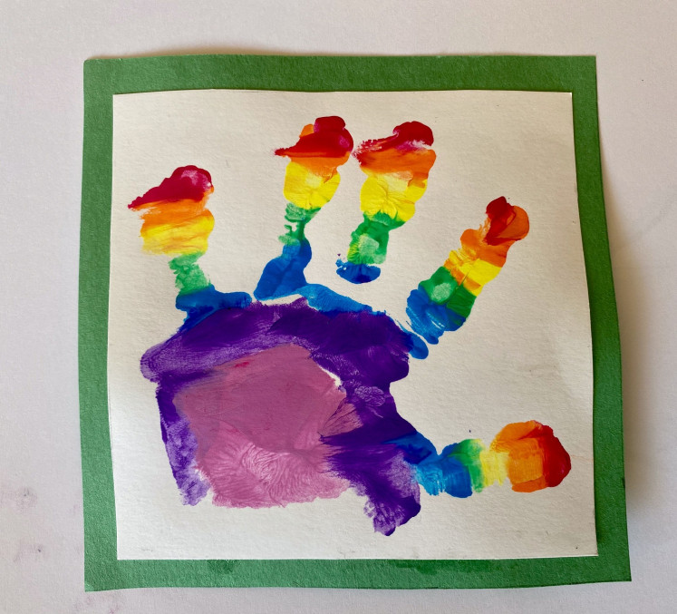 Undated handout photo released by Kensington Palace of Prince Louis' handprint, who celebrates his second birthday on Thursday, taken by his mother, the Duchess of Cambridge, in Britain.