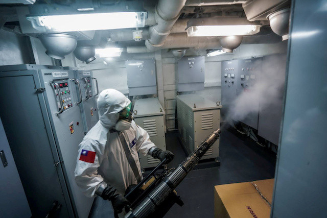 Unnerved by new virus cases in navy, Taiwan debates lockdowns