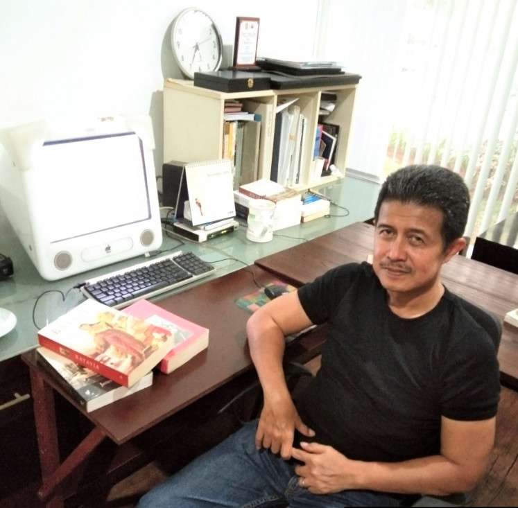 Crafting history: Iksaka Banu, pictured in his home office, is a former advertisement executive who has written several award-winning titles prior to co-authoring 'Pangeran dari Timur' (The Prince from the East) with renowned author Kurnia Effendi.