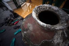 The mosque provides water for wudhu (ablutions) in an earthen jug. JP/Boy T Harjanto