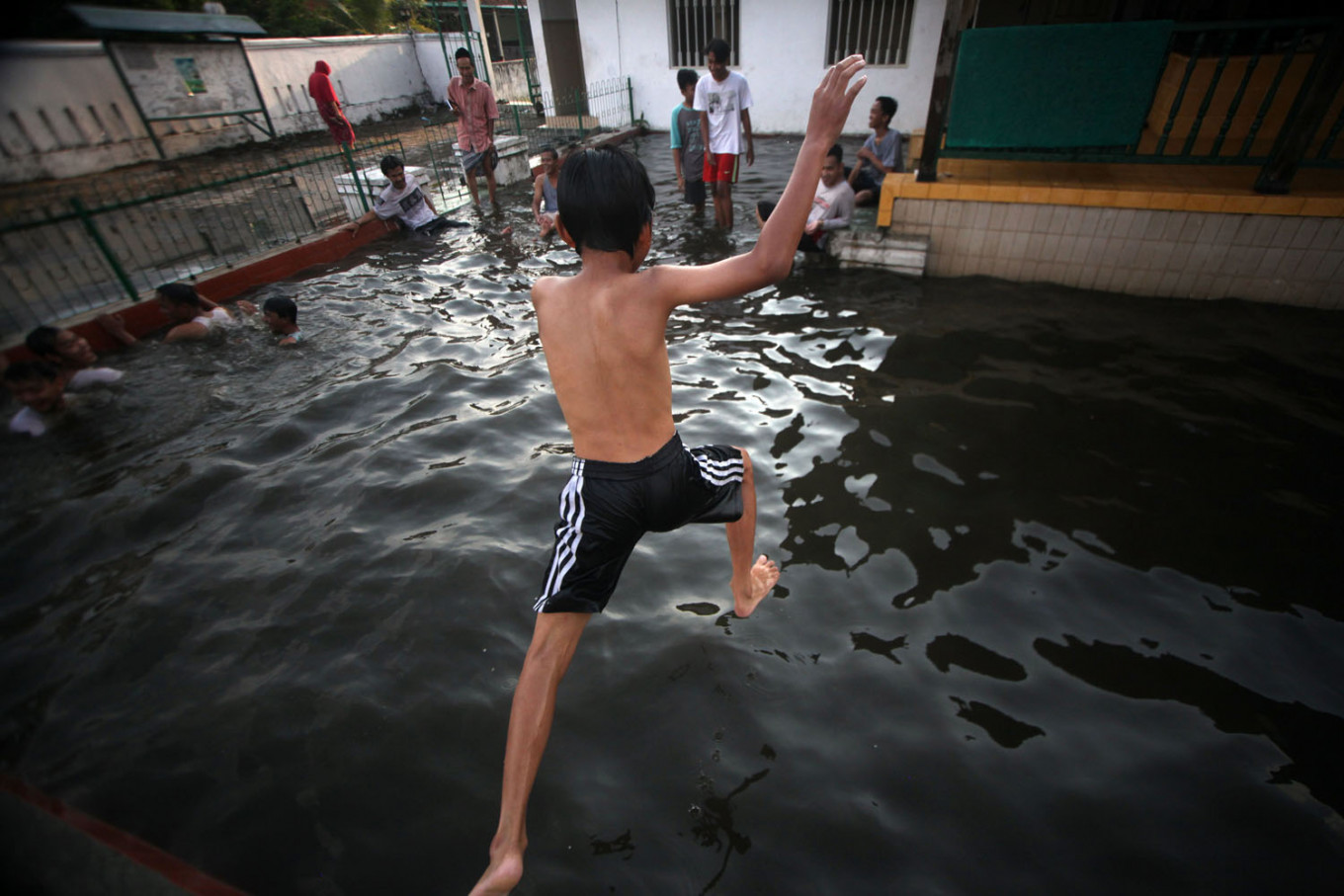 A boy jumps into the pool at Pathok Negoro Mosque in Sleman regency, Yogyakarta. JP/Boy T Harjanto