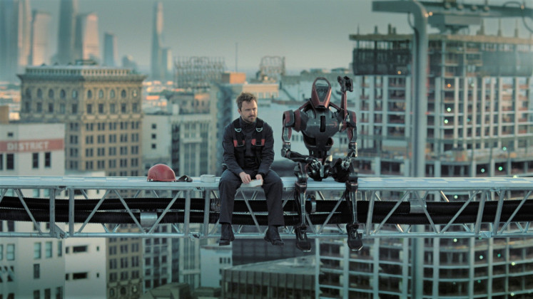 Man and machine: Newcomer Aaron Paul (left) plays Caleb Nichols, a military veteran disillusioned with the system in future Los Angeles.