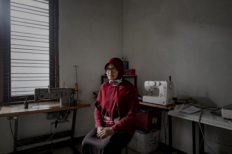 Dwi Rahayu Februarti sits in her mask workshop at her home in Sleman, Yogyakarta. JP/Arnold Simanjuntak