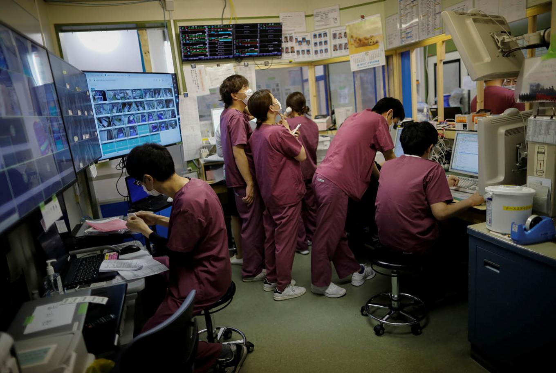 Japan COVID-19 doctors lack fresh masks, hazard pay-union survey