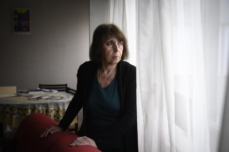 Deportation survivor Florence Schulmann, born in 1945 at the Bergen-Belsen camp poses in Paris on January 23, 2020.