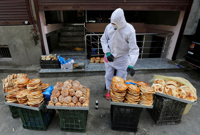 Indian Kashmir locks down, pilgrimage off as virus cases surge