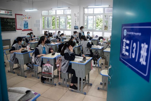Students in China's virus center Wuhan return to school