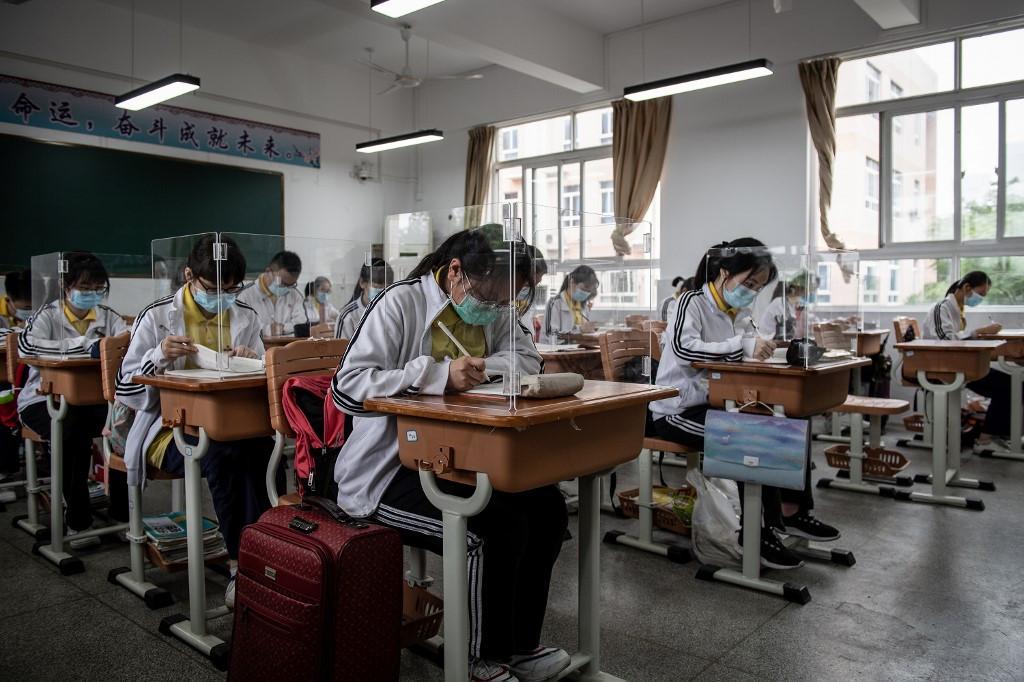 Beijing school students trial temperature-tracking bracelets