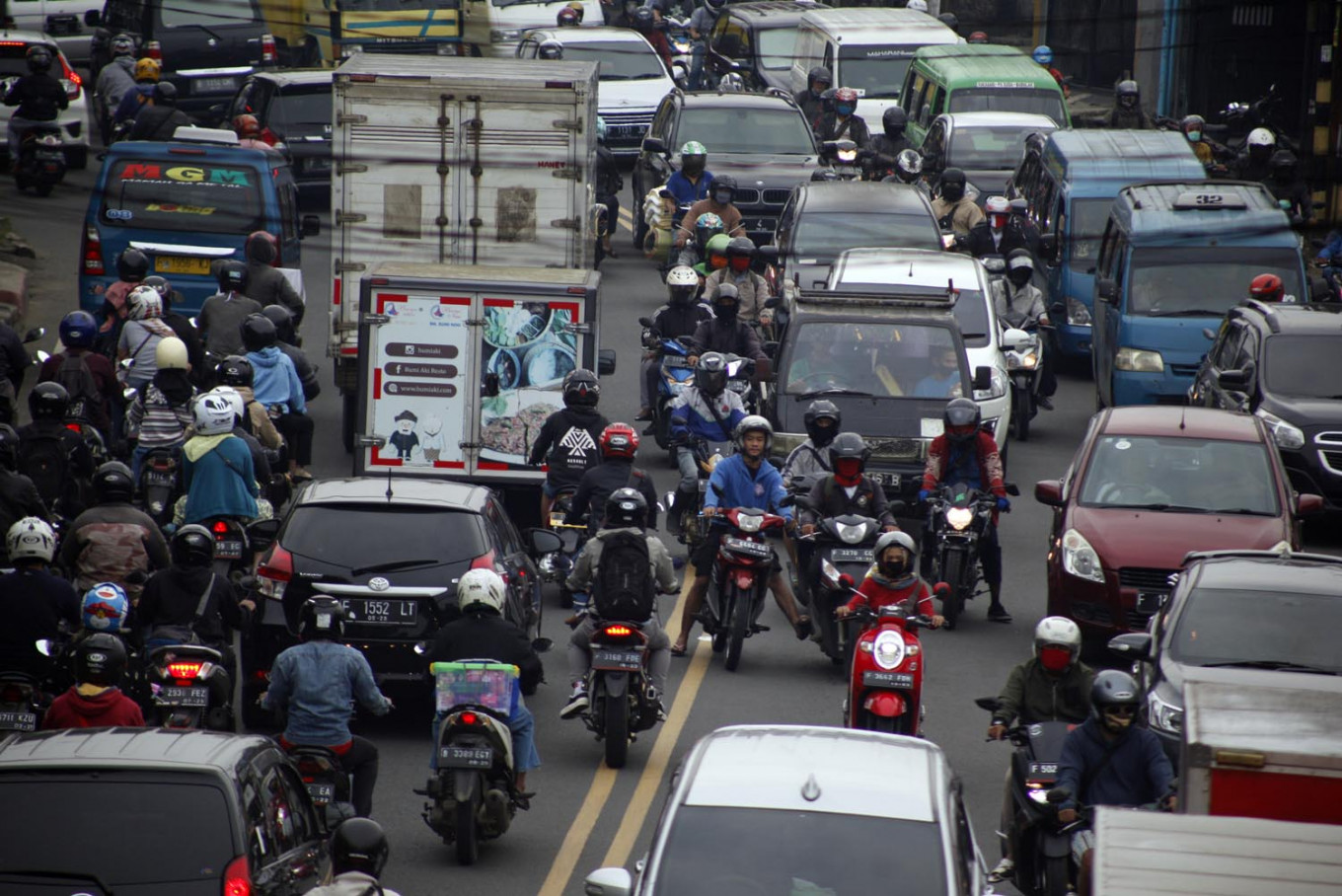 Jakarta's satellite areas extend COVID-19 curbs for second time, with stricter rules