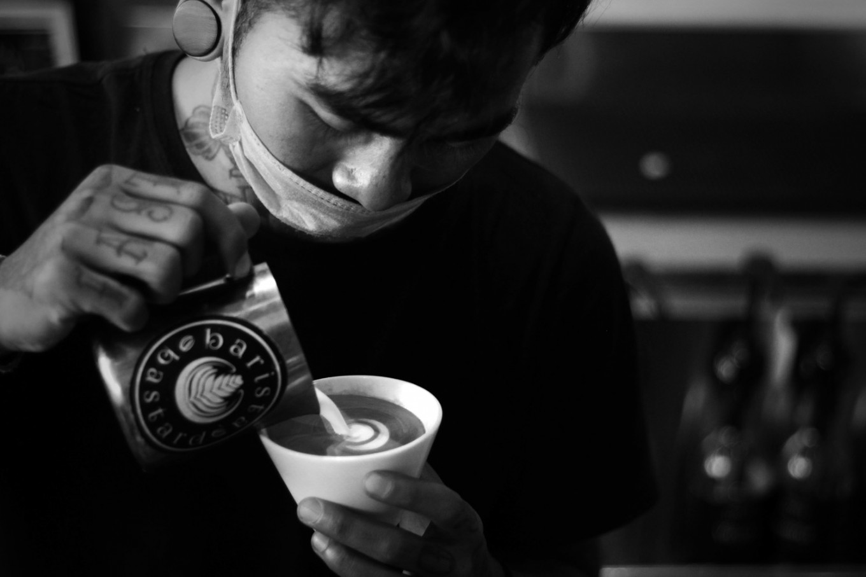 Kadek swirls froth milk into a cup of coffee in a café in Gianyar, Bali. JP/M Azis Dicky
