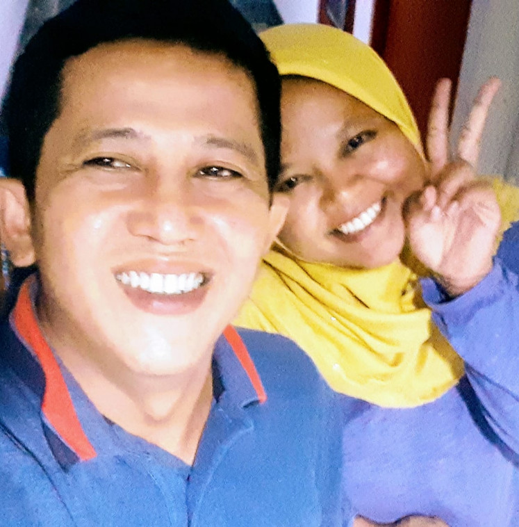Two peas in a pod: Nurse Syahrul Rahmadi (left) poses with his late wife, Ninuk, in this photo from their personal collection. In March, Ninuk was the first nurse to die in Indonesia of COVID-19, after treating patients at the Cipto Mangunkusumo Hospital in Jakarta.