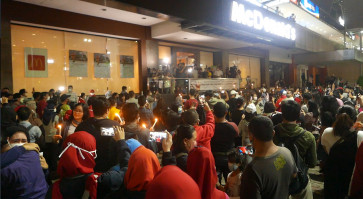 Customers ignore physical distancing to bid farewell to Indonesia's first McDona...