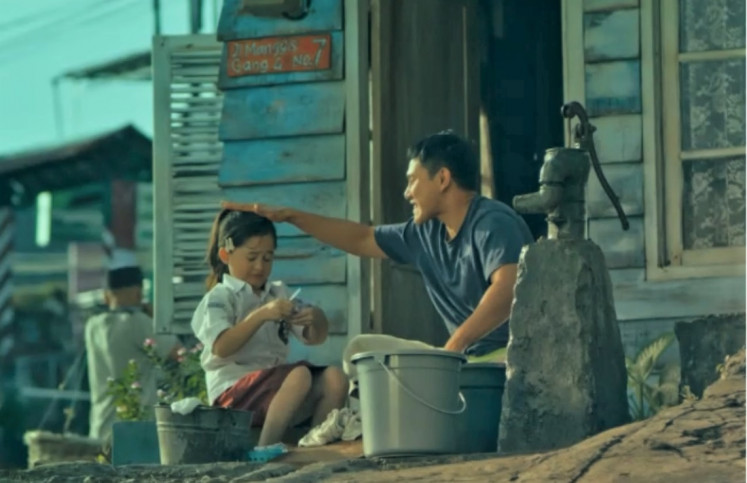 Reality bites: The Indonesian adaptation of South Korean movie 'Miracle in Cell No. 7' features an all-star cast including Vino G. Bastian (right).