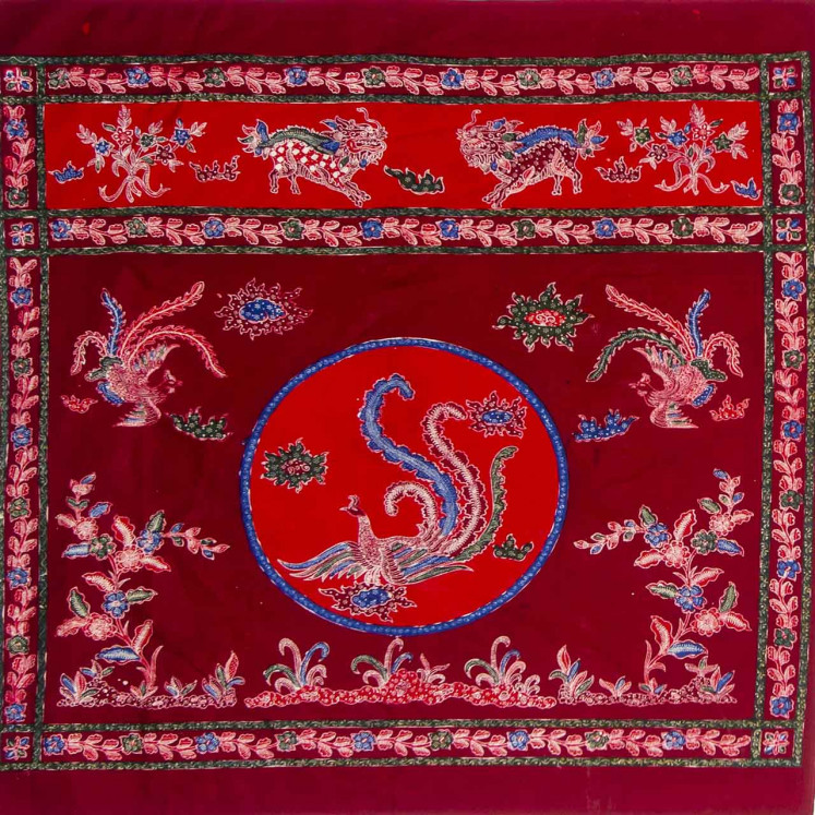 Marriage of cultures: This 'tokwi' (altar runner), produced using the batik 'tulis' technique of hand-applied wax, features patterns inspired by Chinese motifs, including two facing dragons in the upper frame and a central motif of a phoenix. Lasem batik is known for blending Indonesian and Chinese cultural elements.