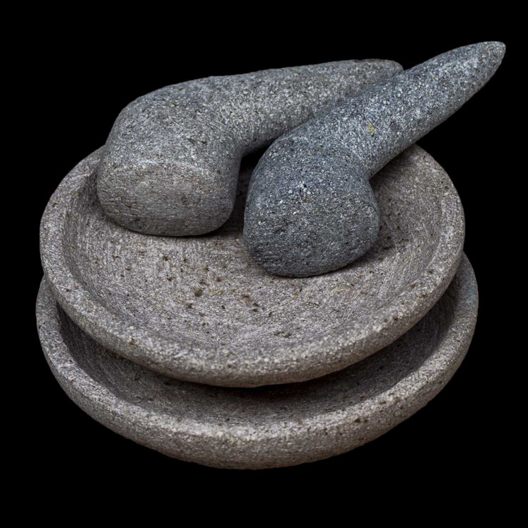 Traditional: This mortar and pestle is created by artisans from the village of Warugunung in Lasem, Central Java. They have honed their skills with natural rocks since the 19th century.