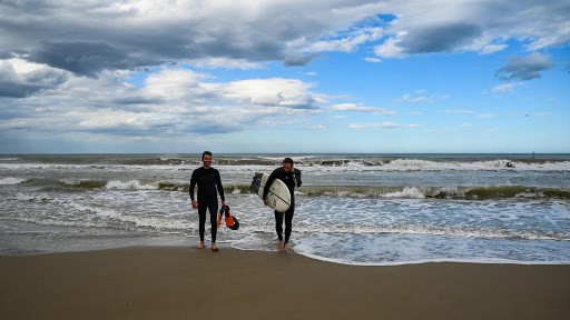 Back on board: Italy's surfers hit beach after lockdown