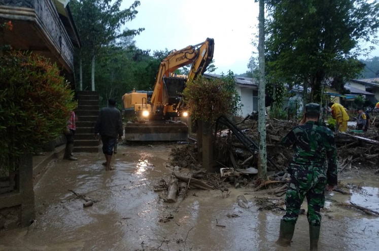 Joint search and rescue team operates heavy machinery to clean flood materials at Paya Tumpi Baru village in Central Aceh regency, Aceh on Wednesday, May 13, 2020. Overnight torrential rain has triggered a flash flood that damages dozens of houses in the village.