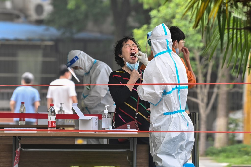 Outbreak quashed, China launches test lab spending spree