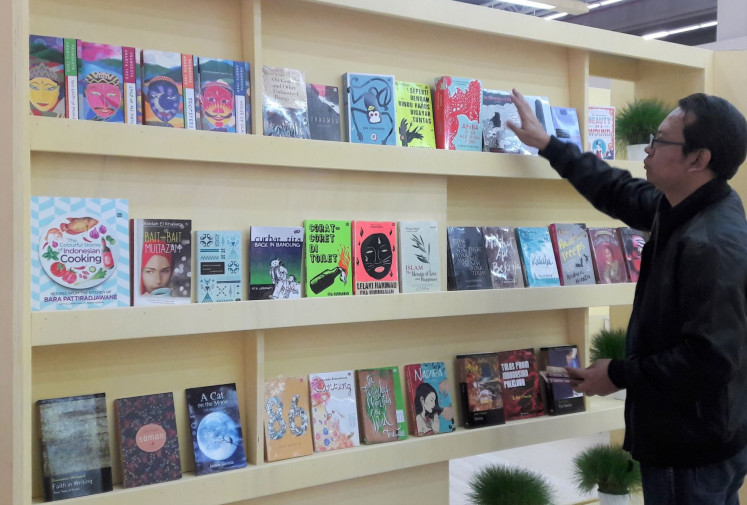 Turning the page: A visitor browses the display of Indonesian books at the 2016 Frankfurt Book Fair.