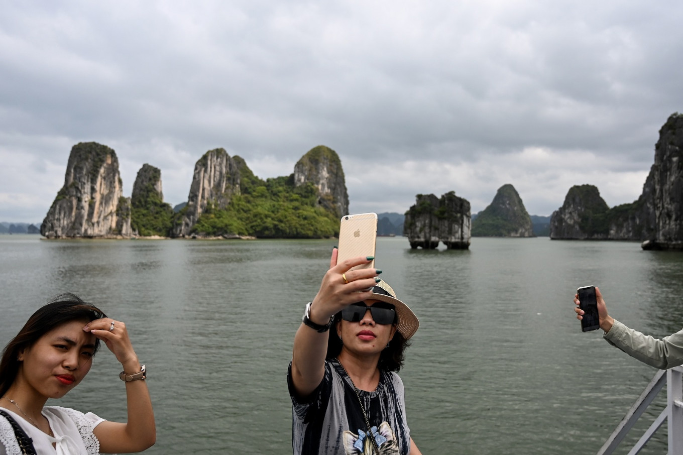 Tourists back in Vietnam's Ha Long Bay as domestic travel opens