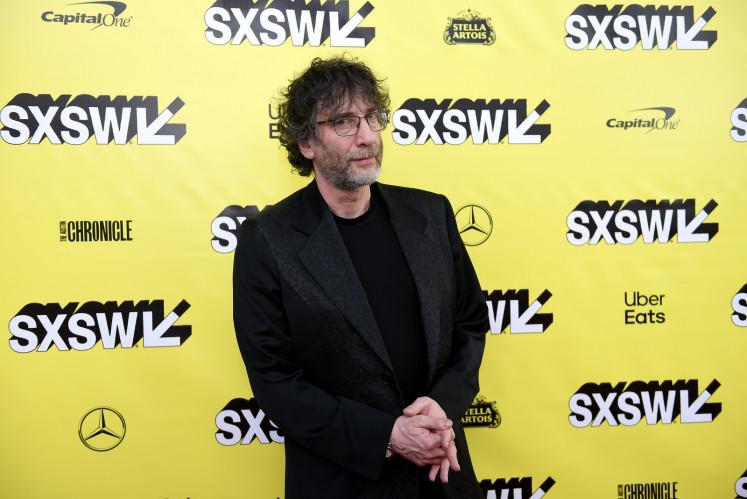 Police warn writer Gaiman over lockdown trip from New Zealand to Scotland