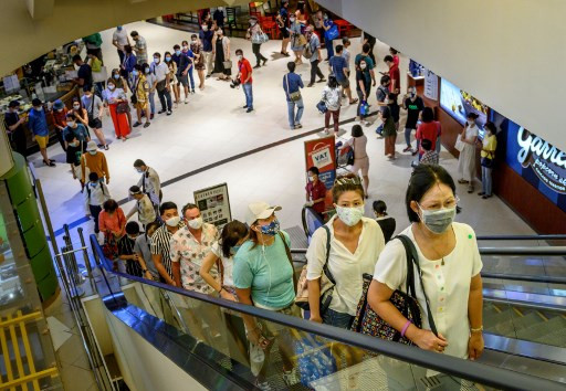 Long queues as Thai malls reopen after virus shutdown