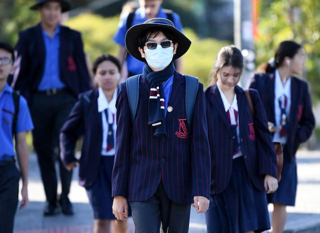 Australian students return to school, Qantas plans return to skies